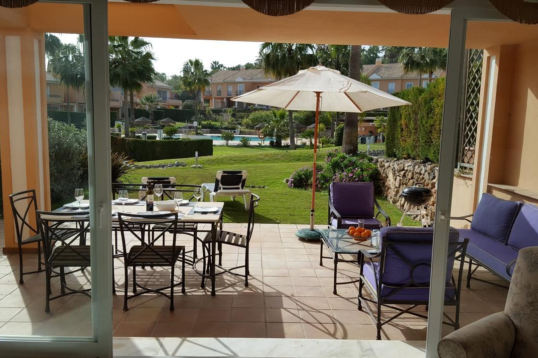 Outside lounge area with dining and sun loungers at 22 Paraiso Park, Benahavis