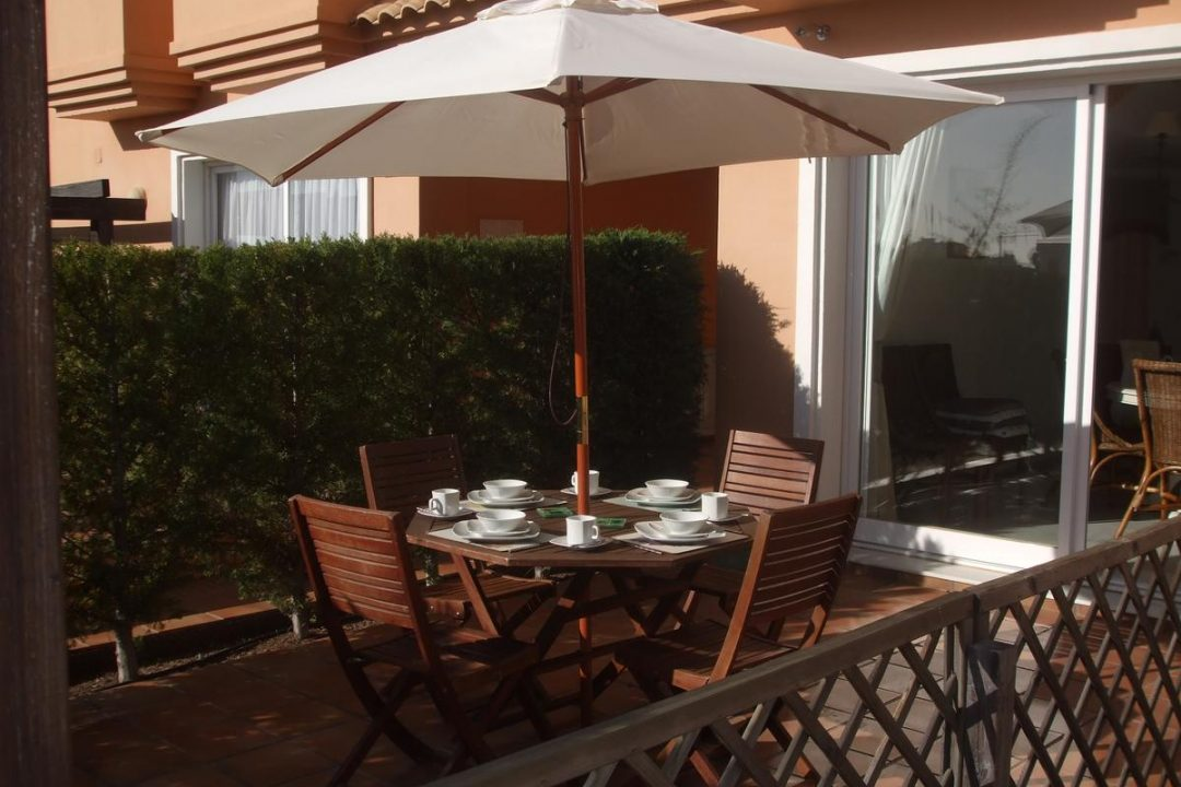Dining area outside apartment at the Paraiso Park complex in Benahavis