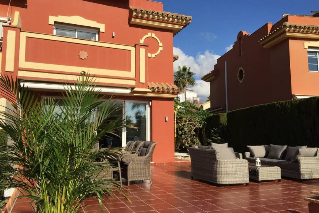 Large ground terrace with lounge area and dining at 72 Monte Biarritz, Benahavis