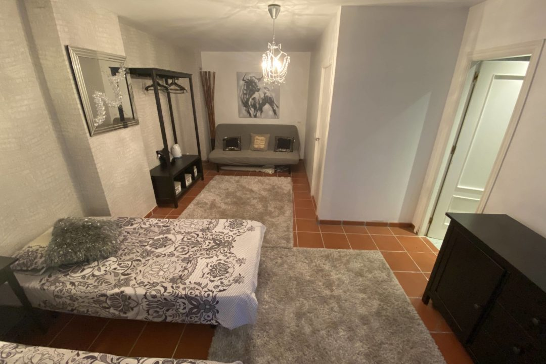 Two single beds in bedroom at Costa Lita Gold Town House, Cancelada