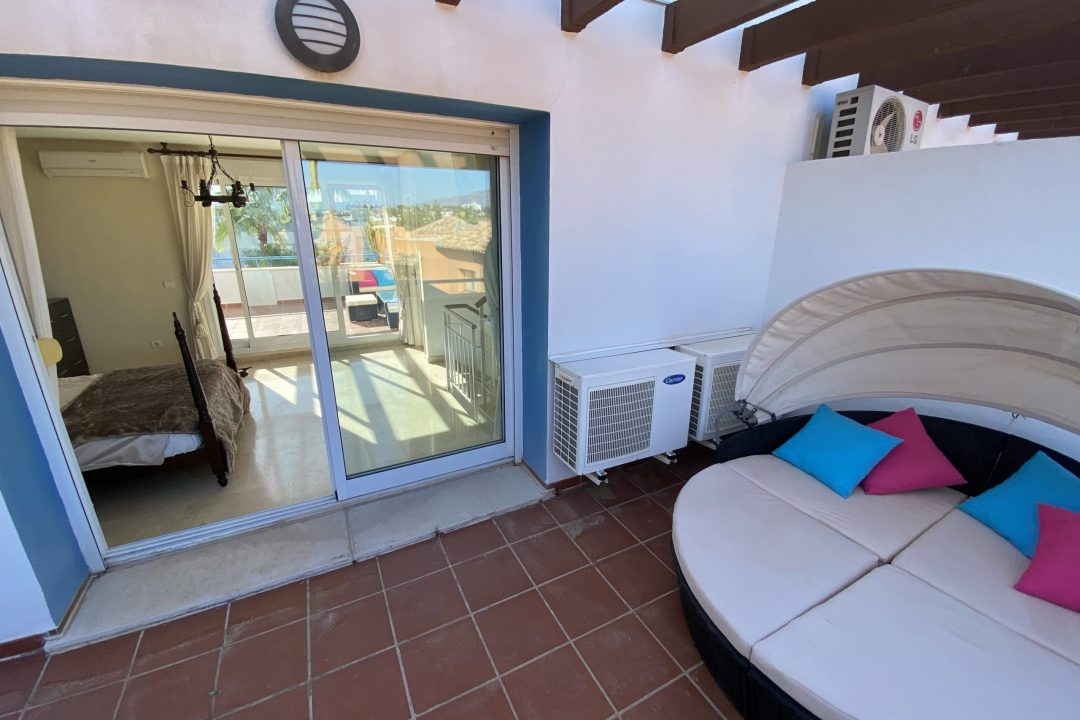 Lounger on outdoor private terrace at Costa Lita Gold Town House, Cancelada