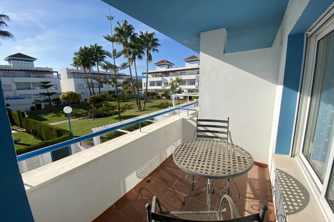 Outdoor balcony area overlooking the communal garden at Costa Lita Gold Town House, Cancelada