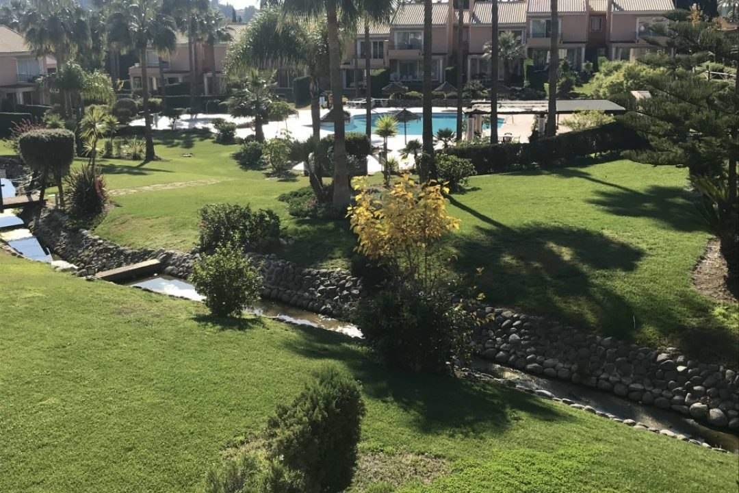 Stunning communal garden area with outdoor pool at Paraiso Park complex, Benahavis
