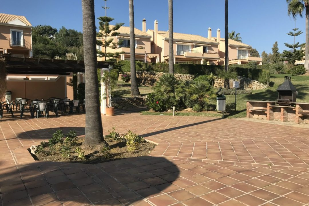 Outdoor terrace area at Paraiso Park complex in Benahavis
