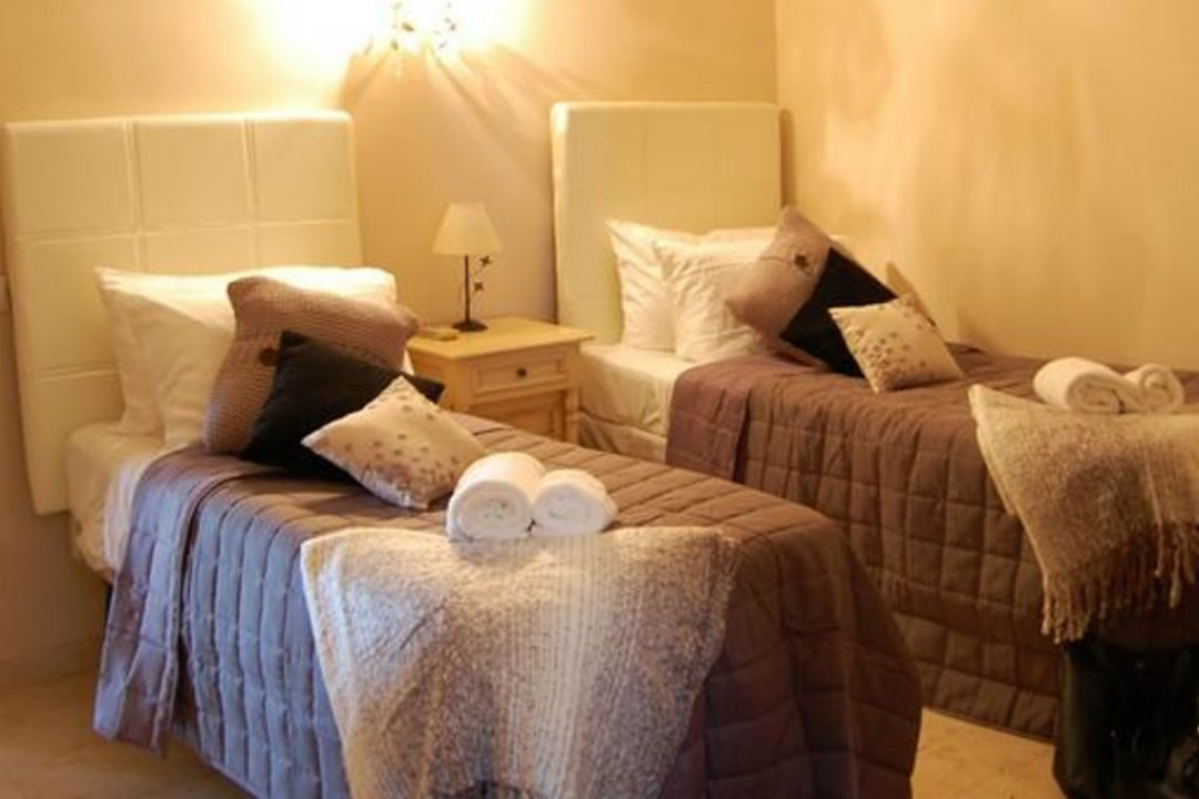Two single beds in bedroom in Villa Nadia on the Golden Mile, Marbella